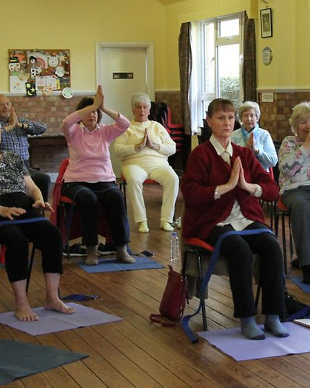 Keeping fit-Chair yoga is held at the Primley URC hall in Sidmouth. Ref shs 15-16SH 0440. Picture: S