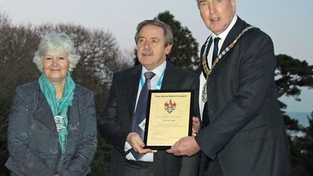 John Lacey, who has been called Britain's nicest traffic warden, received his 10 year service award