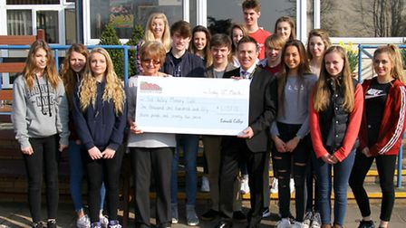 Sidmouth College students present a cheque to Sid Valley Memory Cafe for the Admiral Nurse Campaign.