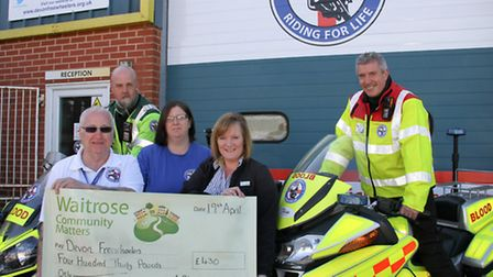 Julie Marish of Waitrose in Sidmouth presents a cheque to Ian Hopkins,Mo Ayling,Caroline Retter and