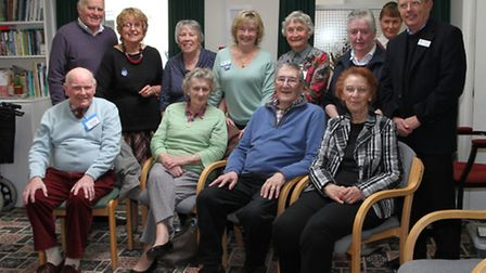 A tea party to celebrate the 80th birthday of the Memory Cafe founder Derek Eagle (seated 2nd right)