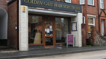 Golden Gate Hair Solutions on Temple Street where recent road resurfacing has left big puddles formi