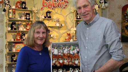 Andrew Coates hands over a box of Bush Babies toys to Sue Scorer this week who will take them out to