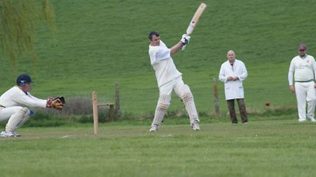 Dave Alford hits out for Tipton St John in the game against Yarcombe and Stockland