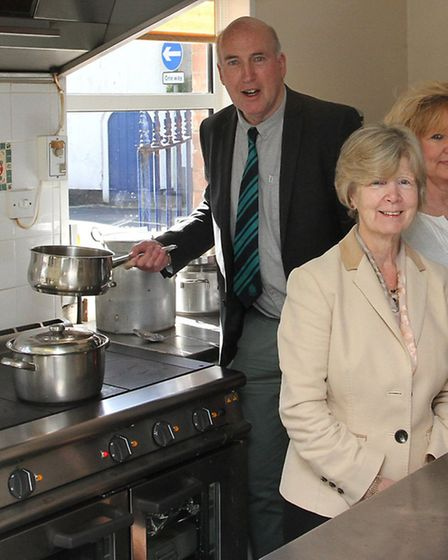 Cooking up a donation-Cllr Stuart Hughes is pictured with some of the team at Twyford House after he