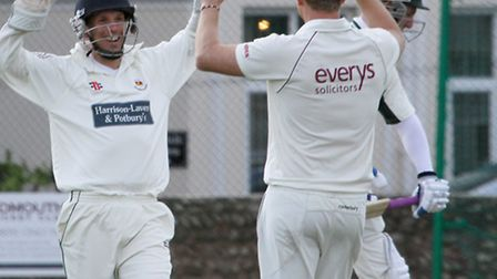 Sidmouth wicket keeper Matt Hewer celebrates a wicket against Taunton Deane. Ref shsp 16-17TI 9538.