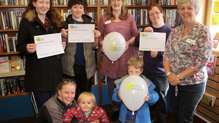 Ottery library staff Sarah Richards and Annette Siddle with library users at their libaries unlimite