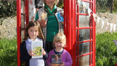 Sheila Mitchlemore with Molly and Beryl Roseveare at the opening of the phonebox library in Fortescu