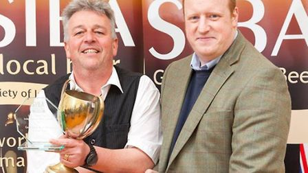 Brewery Owner Paul Dimond collecting his trophy from sponsors Charles Faram Hop Merchants.