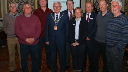 Cheque recipients gather before the annual Sidmouth town council meeting and grant presentation. Ref