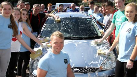 Kings school sixth form students helping out at the Ottery Fire Station car wash. Ref sho 16-17TI 94