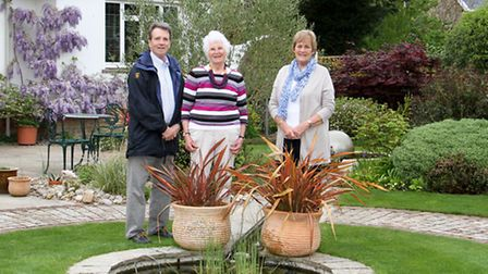 Veronica Wood with Tom DeRemer from Hospiscare and Linda Archard of the memory cafe in her garden. R