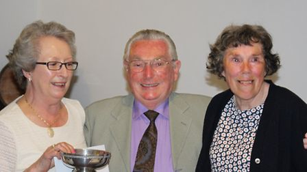 Sidmouth indoor bowls captain Ron Cook presenting Mrs Jill Bishop and Ms Ann Elwood with the ladie