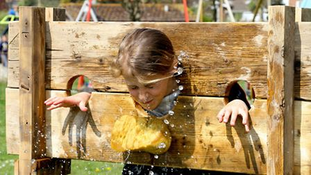 Sidmouth Sea Fest 2016. Lucy Tanner gets soaked in the stocks. Ref shs 19-16AW 6612. Picture: Alex W