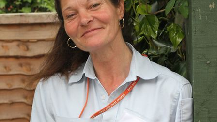 Sidmouth postie Julie Long is raising money for the Sidmouth Hospiscare Trust by taking part in the