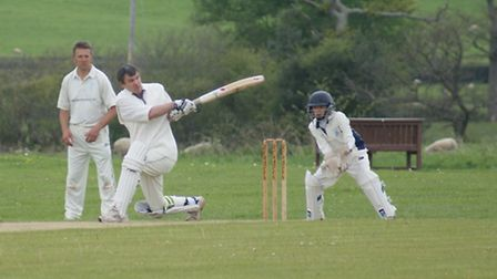 Tipton St John batsman Dave Alford scores runs against the Ottery St Mary bowlers and he passed 2,