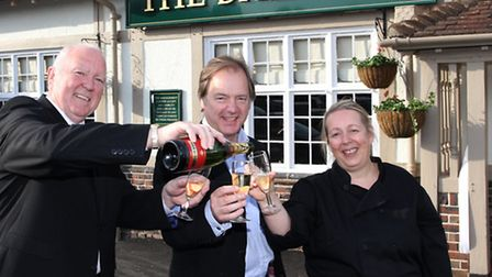 Lovely Bubbly- MP Hugo Swire raises a glass with licensees Ron and Angie Miles as the Balfour is reo
