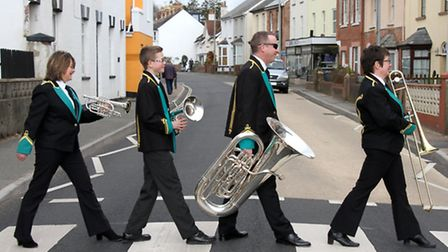 Four members of Sidmouth Town Band recreate the Beatles' Abbey Road album cover on Temple Street. Re