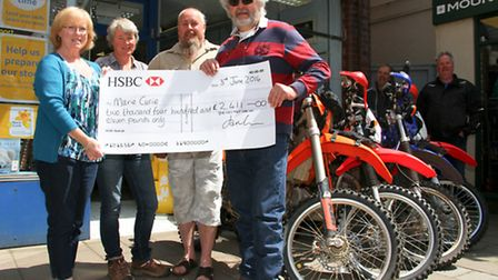 Members from Devon Trail Riders Fellowship presented a cheque to Marie Curie, Sidmouth branch. Carol