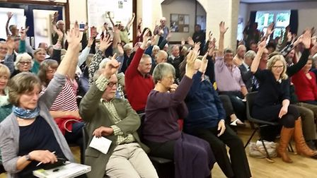 Residents express their opposition to plans for a business park outside Sidford. Ref shs business pa