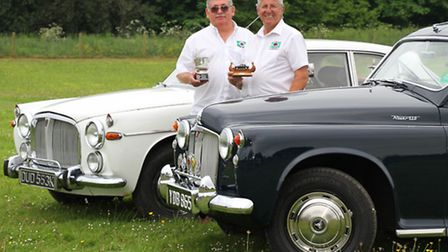 Newton Poppleford resident Ian Hartnell is pictured with his stunning 1964 Rover P4 and his Viking a