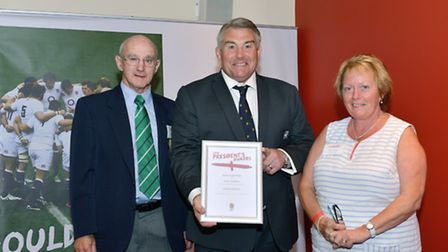 Terry O'Brien and Kerin Hamill are shown receiving the certificate from RFU president Jason Leonard