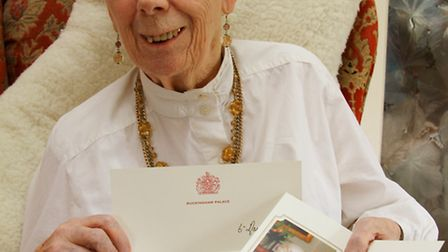 Betty Williams with a thank you letter from the Queen for a poem she wrote for the Queen's 90th birt