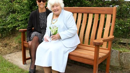 Joy and Jo Seward sat on the newly installed bench at Stevens Cross. Ref shs 21-16AW 7937. Picture: