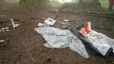 A tent and pizza boxes were among the litter found at Core Hill