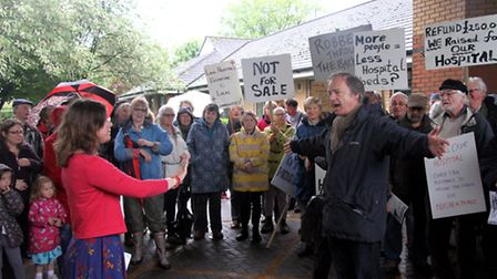 Claire Wright and MP Hugo Swire with protesters at Ottery St Mary hospital on Saturday Ref sho 21-16