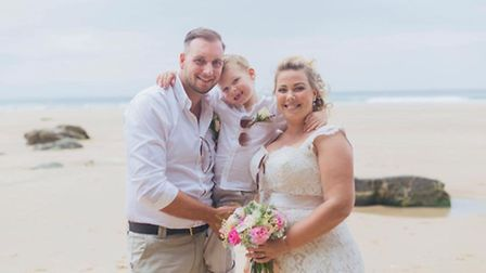 Naomi and her husband Graham and son Devon at their recent Vow Renewal which they do each year on th
