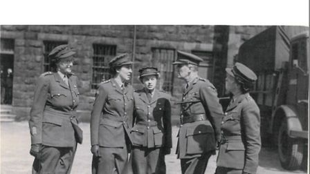 Nancy Bowstead (middle) and two other officers being inspected by Major General Moorhead at Preston