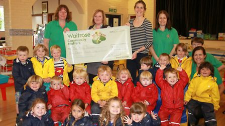 The Byes Pre-School recieving a £400 cheque from Julie Marish of Waitrose to go towards the school's