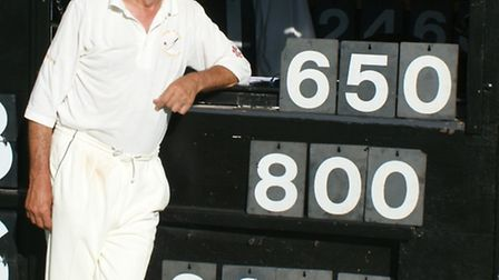 Phil Wright alongside the score board that shows his appearances, wickets and runs for Tipton St Joh