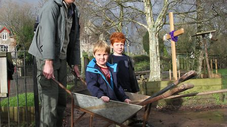 Phil Grover with sons Tom five and seven year old Billy turn up to help in cleaning the playground a
