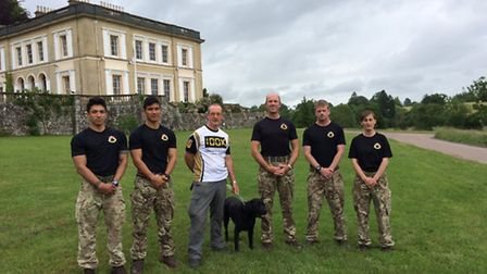Blind veteran John Evans at Escot Park with the group that will be joining him on 100km chairty trek