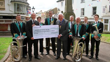President of the Chamber of Commerce Derek Parry handing over a cheque to Sidmouth Town Band. Ref sh