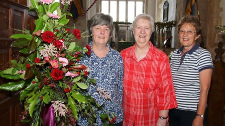 Branscombe flower show at St. Winifred's church. Flower arrangers Daphne Goodier, Pat Morgan and Pat