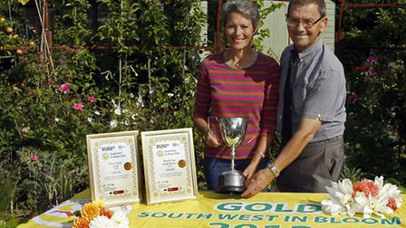 Lynette Talbot and Peter Endersby celebrate the gold southwest in bloom award for 2013. Photo by Ter