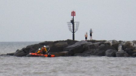Sidmouth Lifeboat crew warn people of the dangers of climbing on the rock breakwaters this week. Ref