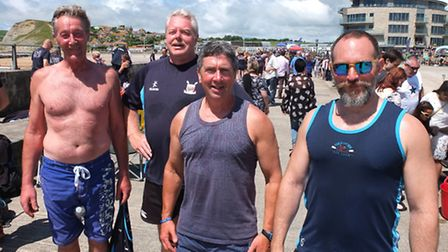 Four of the Sidmouth Gig Club men's team back on dry land and looking very warm: (Left to right) Ala