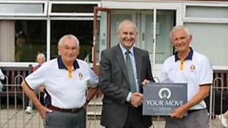 Sidmouth tournament organiser Ron Cook and men's vice captain Mike Borst, either side of Jim Edwards