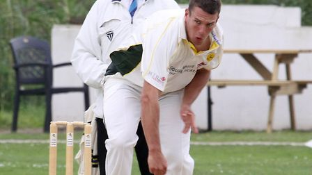 Budleigh bowler Scott Barlow in action at the Ottermouth againgst North Devon on Saturday. Photo by