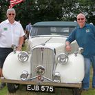 Ian Hartnell and Ken Newton,organisers of the classic car day in Sidford, with 'Robbie The Rover' a