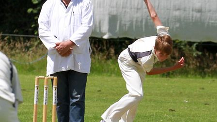 Tom Jeacock bowling for Ottery 2nds at home to Plymstock. Ref shsp 27-16TI 3504. Picture: Terry Ife