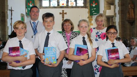 Sidmouth Primary School pupils after the service with head teacher Paul Walker,Rev. Suzie Williams a