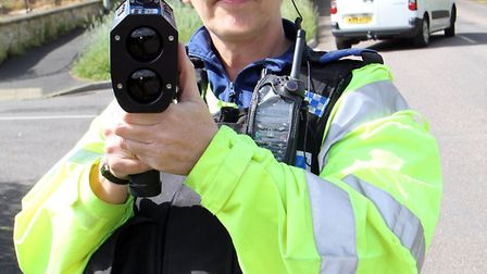 PCSO Maria Clapp tests out a speed gun in Ottery St Mary. Picture by Alex Walton. Ref sho 2617-21-14