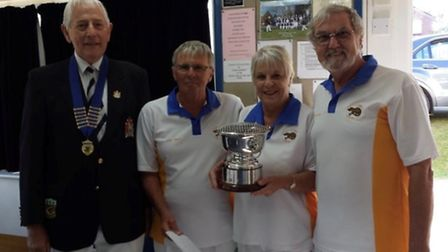 Ottery St Mary bowlers John and Terri Ward and Terry House with the Uffculme Triples Trophy