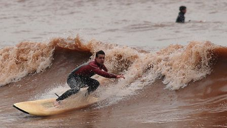 Jake Hurson surfing off Sidmouth