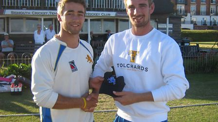 Zak Bess (left) receives his county cap from brother and team-mate Josh Bess after his unbeaten cent
